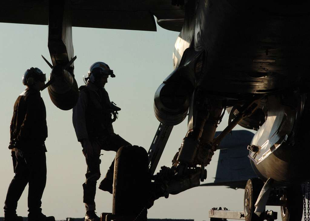 A pilot, assigned to the Bulls of Strike Fighter Squadron Three Seven (VFA-37), prepares to climb up the boarding ladder to the cockpit of his F/A-18C Hornet prior to flight operations .