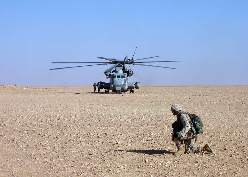 A U.S. Marine, assigned to 3rd Light Armored Reconnaissance Battalion (LAR), provides security near a CH-53E Super Stallion helicopter near Ar Rutbar, Iraq.