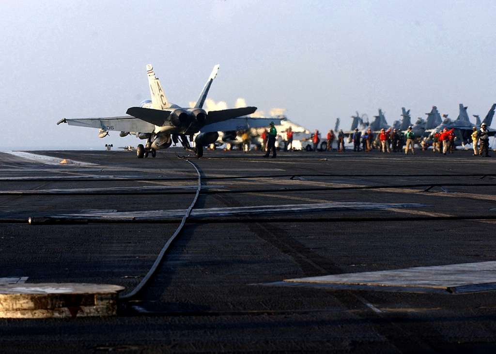 An F/A-18A+ Hornet assigned to Marine Fighter Attack Squadron One One Five (VMFA-115) Silver Eagles catches one of the four arresting wires during aircraft recovery aboard USS Harry S. Truman (CVN 75).