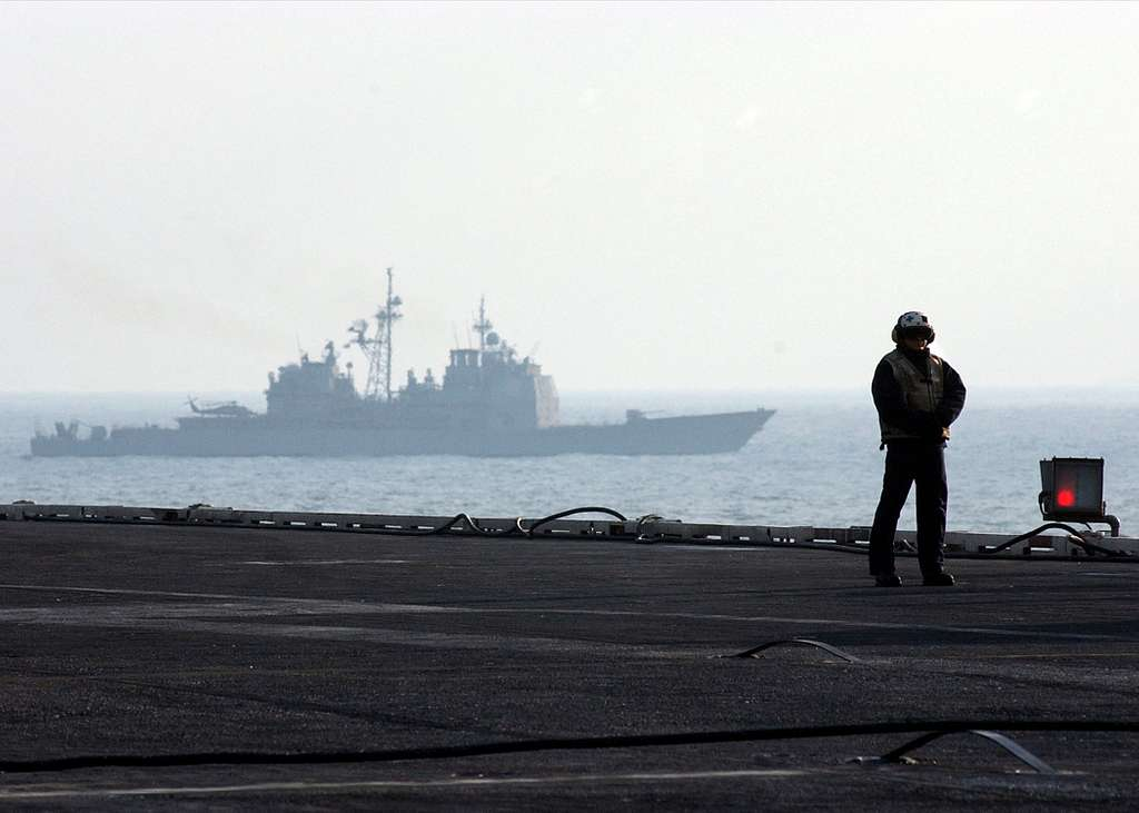 The guided missile cruiser USS Monterey (CG-61) performs duties as Plane Guard during flight operations aboard the Nimitz-class aircraft carrier USS Harry S. Truman (CVN 75).