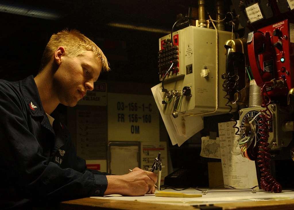 Aviation Warfare Systems Operator 2nd Class Eric Benson plots the position of U.S. Coast Guard cutter Wrangle in relation to USS Harry S. Truman (CVN 75) in the ship's Anti-Submarine Warfare Module.