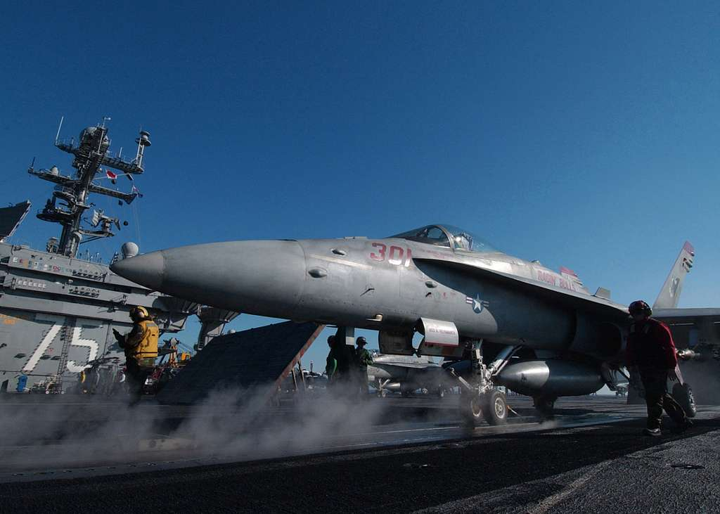 An F/A-18C Hornet, assigned to the Bulls of Strike Fighter Squadron Three Seven (VFA-37), moves into position onto one of four steam powered catapults.