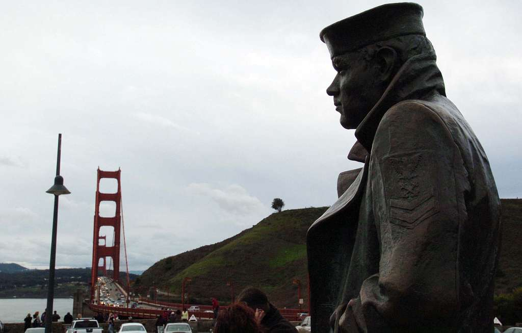 The Lone Sailor Memorial at Vista Point Outlook on the northern end of the Golden Gate Bridge offers scenic views of San Francisco, the Golden Gate Bridge and historic Alcatraz prison.