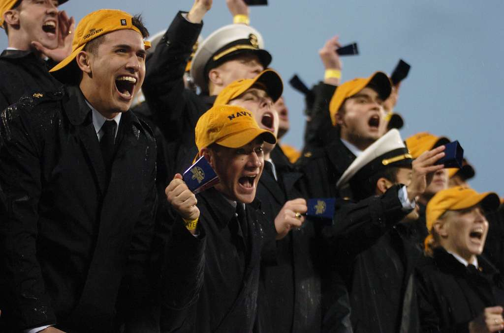 U.S. Naval Academy Midshipman in the stands cheer as the clock ticks down against the Lobos of New Mexico at the Emerald Bowl in San Francisco.