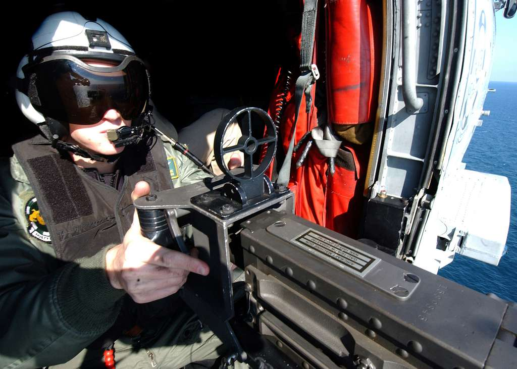 Aviation Warfare Systems Operator 3rd Class Walton Stone assigned to Helicopter Anti-Submarine Squadron Seven (HS-7) mans an .50 caliber machine gun.
