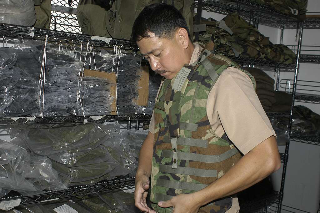 Chief Hospital Corpsman Alberto Redublo of Naval Environmental and Preventive Medicine Unit Six (NEPMU-6) inspects equipment he will need for deployment to Indonesia.