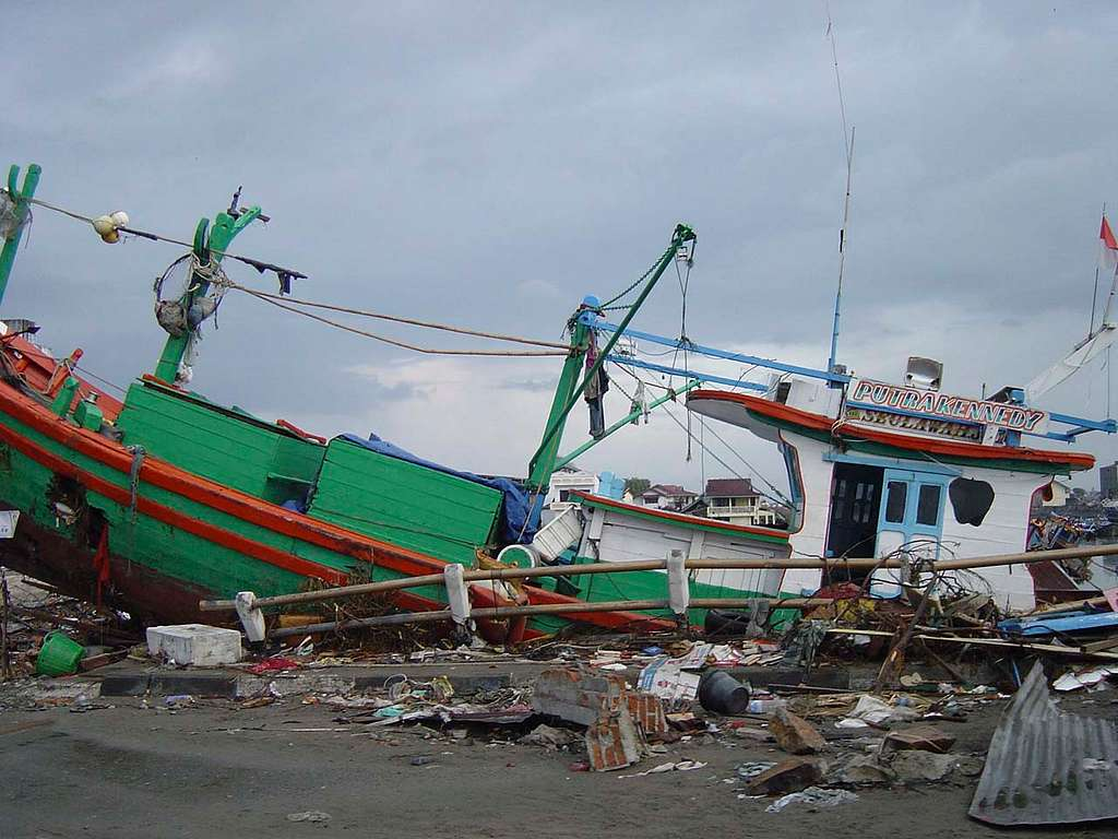 Boats washed ashore near local businesses in down town Aceh, Sumatra following a massive Tsunami that struck the area on the 26th of December 2004.