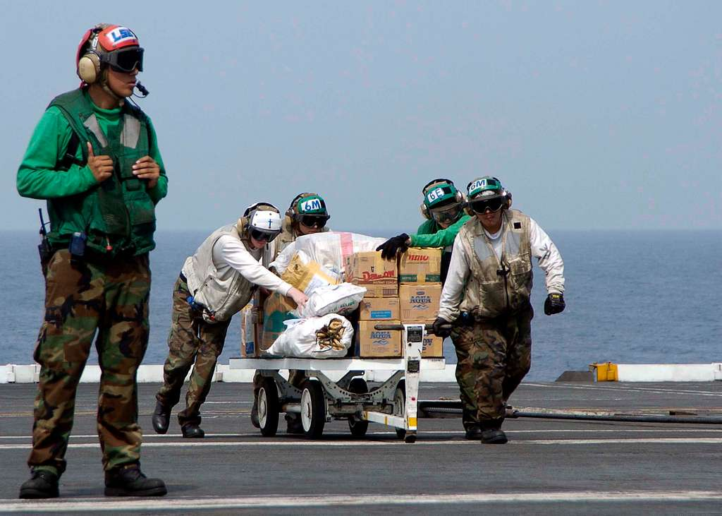 Boxes of water and food are staged aboard USS Abraham Lincoln (CVN 72) prior to being loaded onto SH-60B Seahawk helicopter.