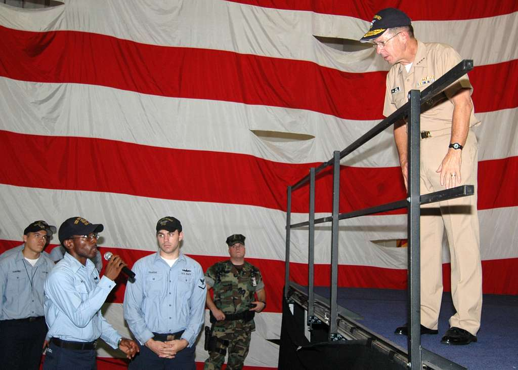 A Sailor asks a question to Chief of Naval Operation (CNO) Adm. Mike Mullen during an all hands call for E-6 and below Sailors of Naval Station Mayport.