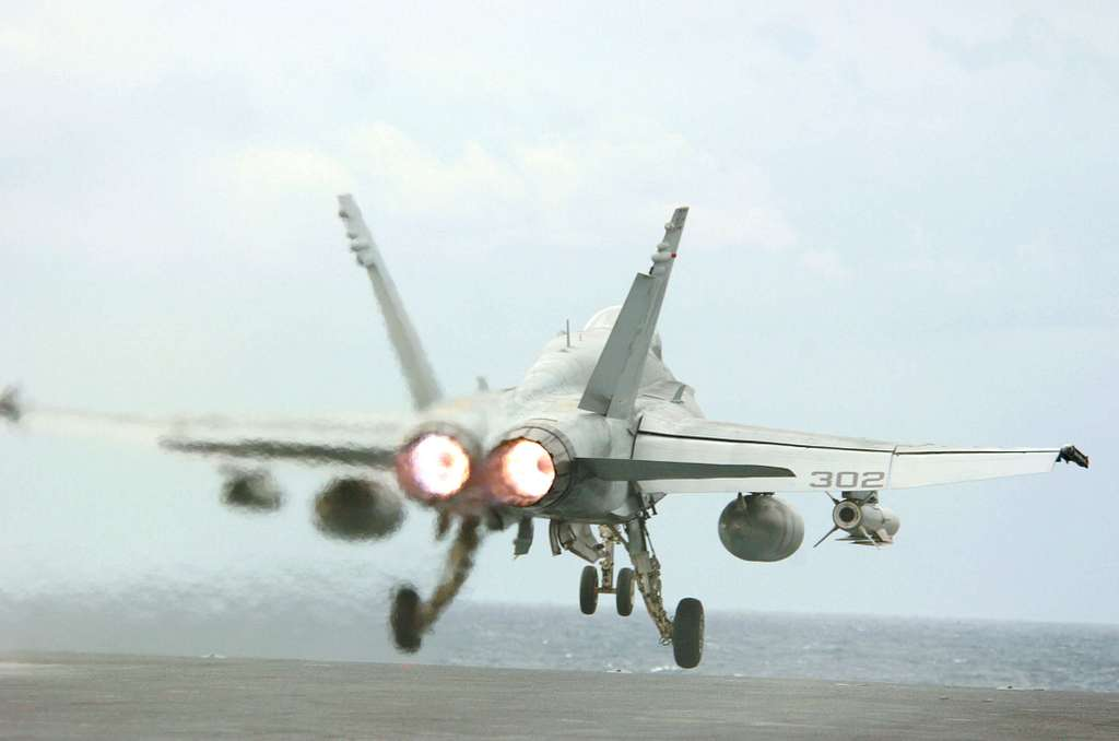 An F/A-18C Hornet, assigned to the Golden Dragons of Strike Fighter Squadron One Nine Two (VFA-192), launches from the flight deck of the conventionally powered aircraft carrier USS Kitty Hawk (CV 63).