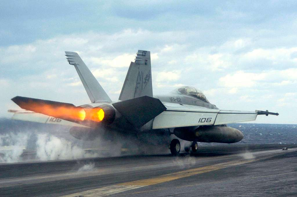 An F/A-18F Super Hornet, assigned to the Diamondbacks of Strike Fighter Squadron One Zero Two (VFA-102), launches from the flight deck aboard USS Kitty Hawk (CV 63).