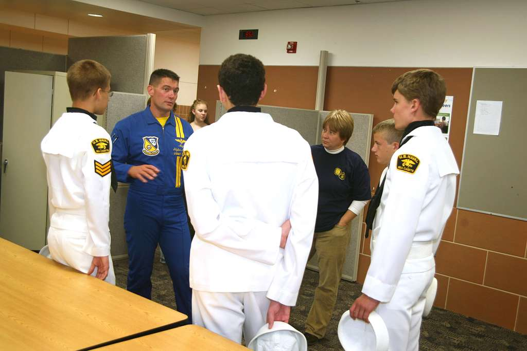 Blue Angel�s C-130 pilot Maj. Stefan Mueller talks with U.S. Sea Cadets at Lincoln North Star High School. - PICRYL Public Domain Image