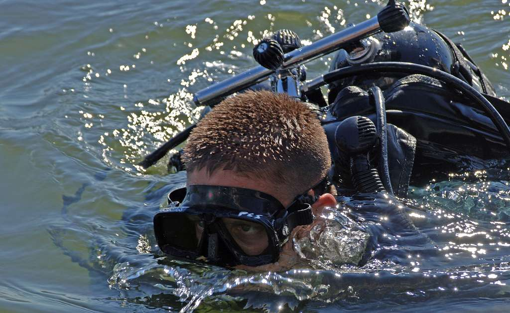 Utilitiesman 1st Class Paul Sarniak prepares for a dive at Naval Station Norfolk. Sarniak assisted in the delivery of a replica of the Discovery to the British fleet stores ship Royal Fleet Auxiliary Fort Rosalie (A385).