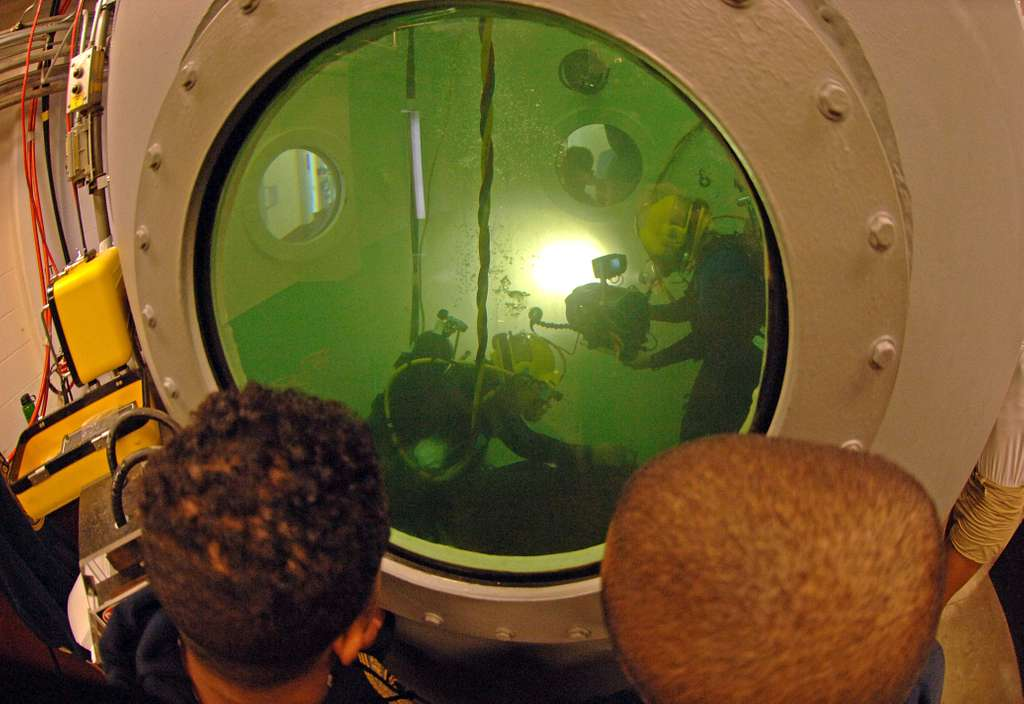 Mass Communication Specialist 2nd Class Christopher Perez films a student performing the Drill, Tap, and Grind portion of the Second Class Diver course at the Navy Diving & Salvage Training Center.
