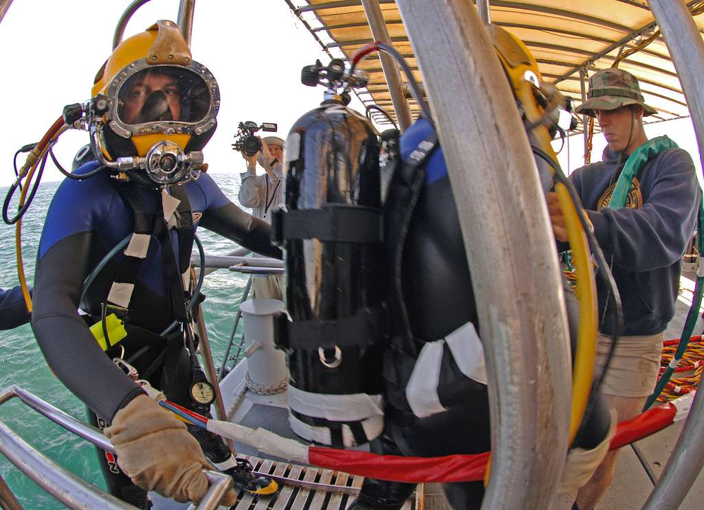 Machinist�s Mate Fireman Kris Hale, enrolled in the Second Class Diver course at the Navy Diving & Salvage Training Center, waits to be helped off of the stage after a training dive.
