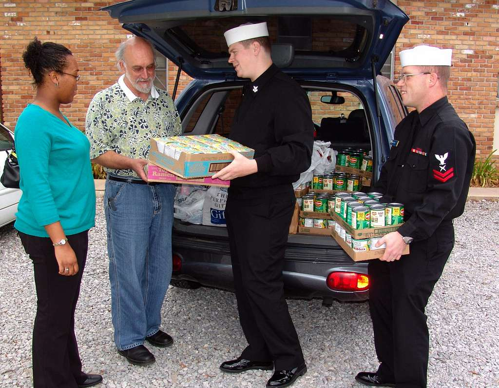 Cryptologic Technician Collection 1st Class Robert Paul and Cryptologic Technician Collection 2nd Class Lance Burney, assigned to the Center for Informatioin Dominance (CID) Corry Station, deliver the last installment of food and supplies.