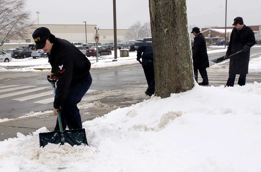 Machinist�s Mate 3rd Class Michael Kilpatrick shovels snow from the sidewalks at Submarine Base New London.