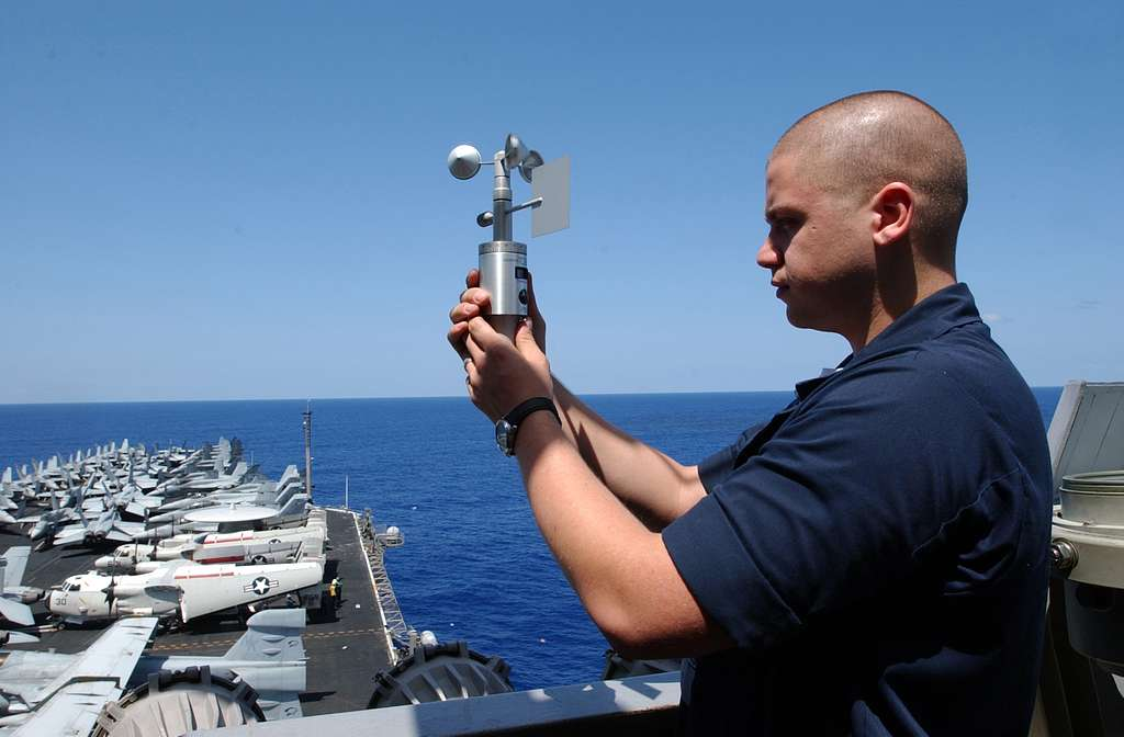 Aerographer�s Mate 3rd Class Heath Collins, from Kirbyville, Texas, uses an anemometer to take a reading of the current local wind speed and direction on board Nimitz-class aircraft carrier USS Ronald Reagan (CVN 76).
