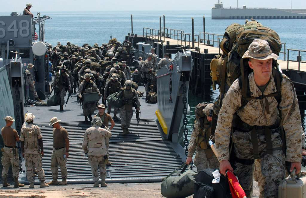 Marines assigned to the 13th Marine Expeditionary Unit (MEU) offload a Landing Craft Utility (LCU) after disembarking USS Bonhomme Richard (LHD 6) The LCU is assigned to Assault Craft Unit (ACU) 1 Det Delta.