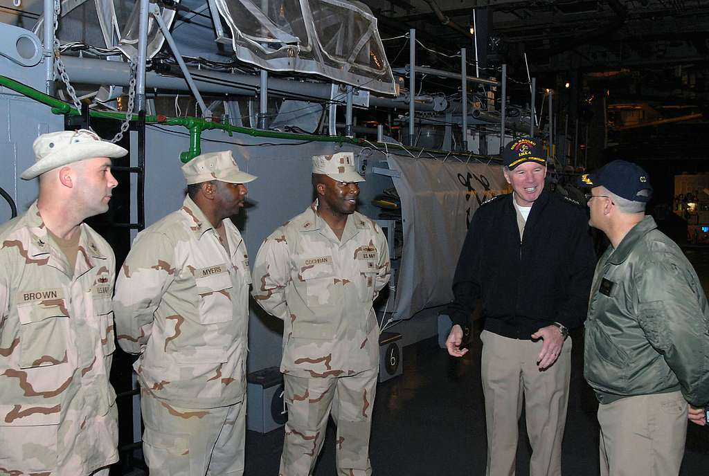 Adm. Mark P. Fitzgerald, commander of U.S. Naval Forces Europe and Allied Joint Force Naples speaks with Capt. James R. Boorujy, commanding officer of the amphibious assault ship USS Nassau (LHA 4) and members of Assault Craft Unit 2.
