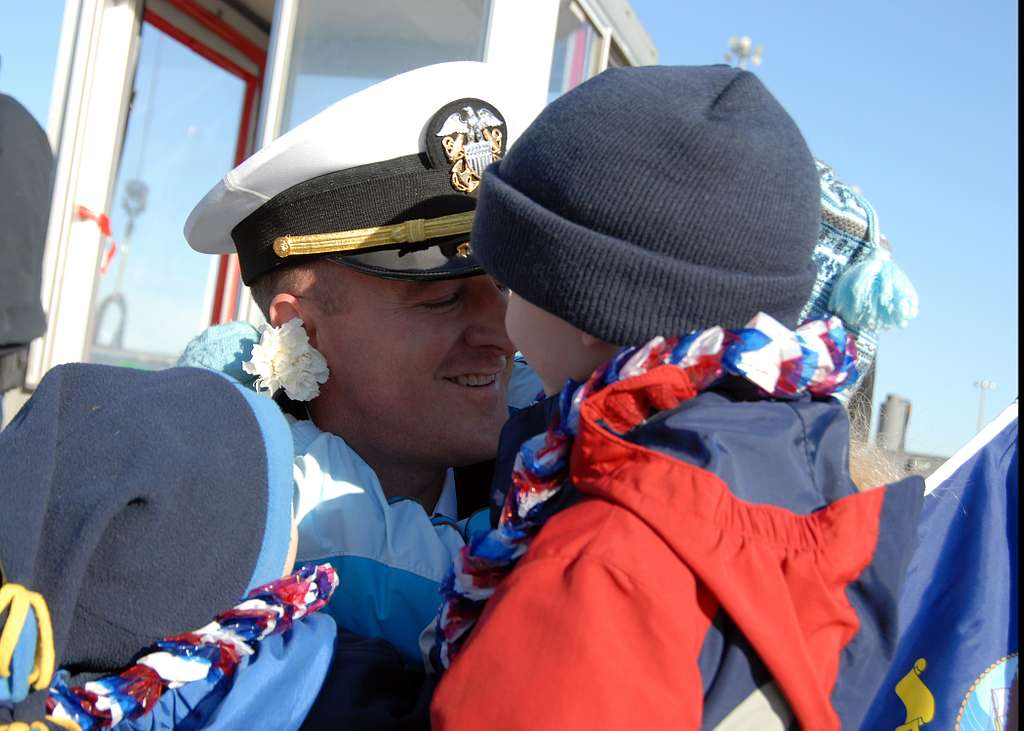 Lt. Cmdr Brad Terry embraces his children for the first time in six months after returning to Naval Station Norfolk.