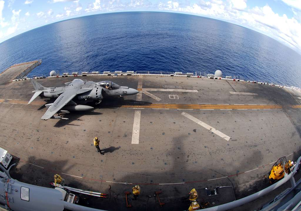 Sailors assigned to Marine Medium Helicopter Squadron (HMM) 163 and air handlers assigned to the amphibious assault ship USS Boxer (LHD 4) conduct AV-8B harrier flight operations.