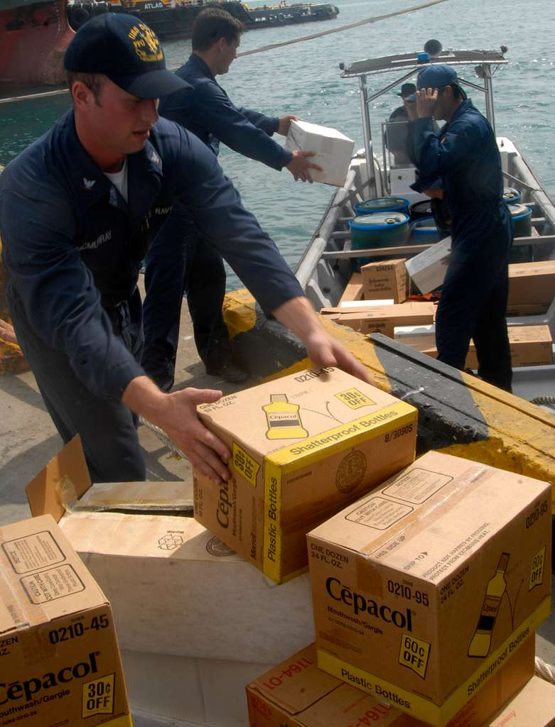 Gunner's Mate 2nd Class Matthew Mcmurray brings medical supplies ashore during a Project Handclasp delivery to a Colombian Coast Guard vessel.