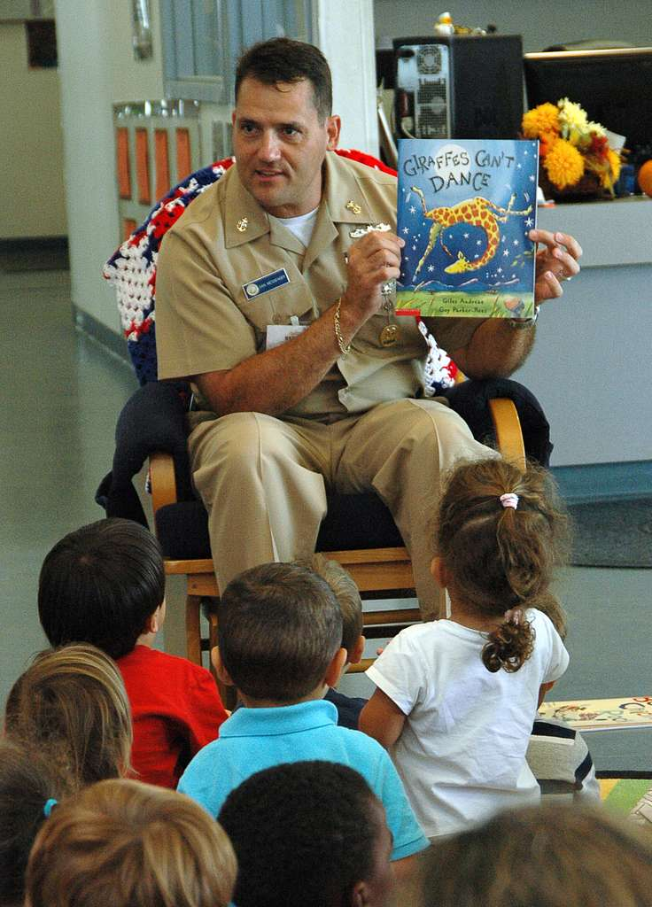 Naval Air Station Key West Command Master Chief Dan Messenger reads a book at the Naval Air Station Key West Child Development Center.