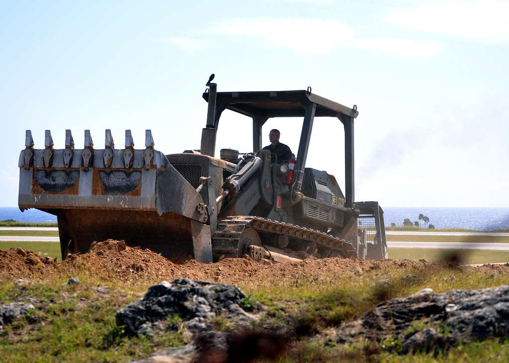 onstruction Mechanic 2nd Class Jacob Seichter operates a bulldozer at the airfield at Naval Station Guantanamo Bay.