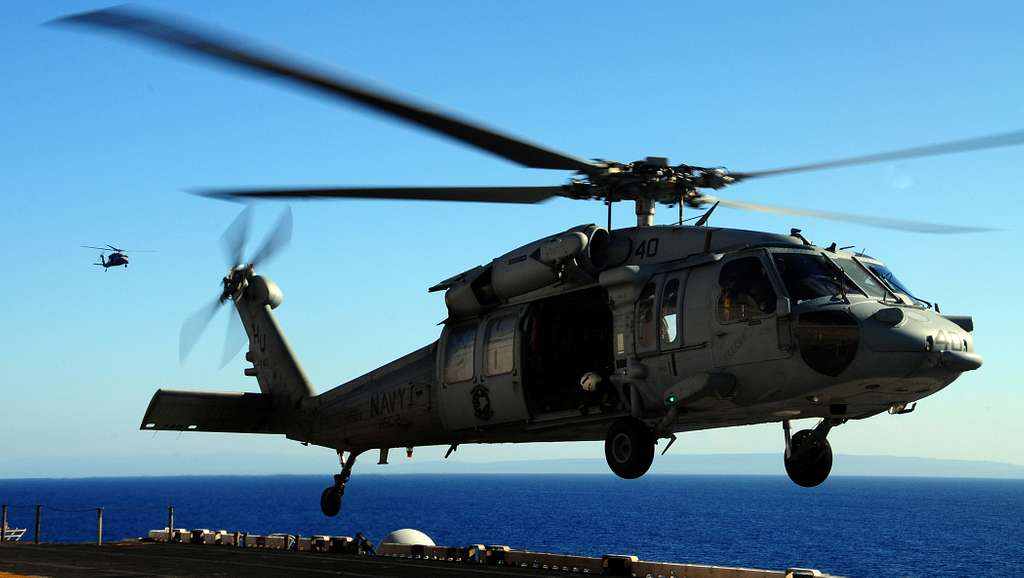 An MH-60S Sea Hawk helicopter assigned to Helicopter Sea Combat Squadron (HSC) 22 prepares to carry supplies from the Military Sealift Command dry cargo and ammunition ship USNS Sacagawea (T-AKE 2)
