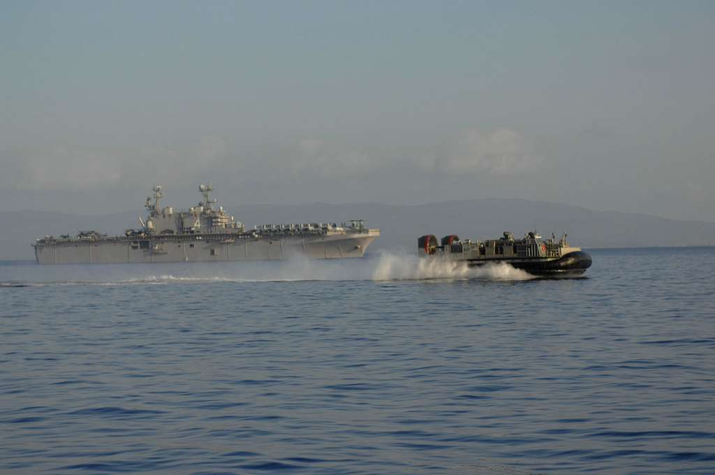 A landing craft air cushion (LCAC) operates next to the amphibious assault ship USS Nassau (LHA 4) off the coast of Haiti.