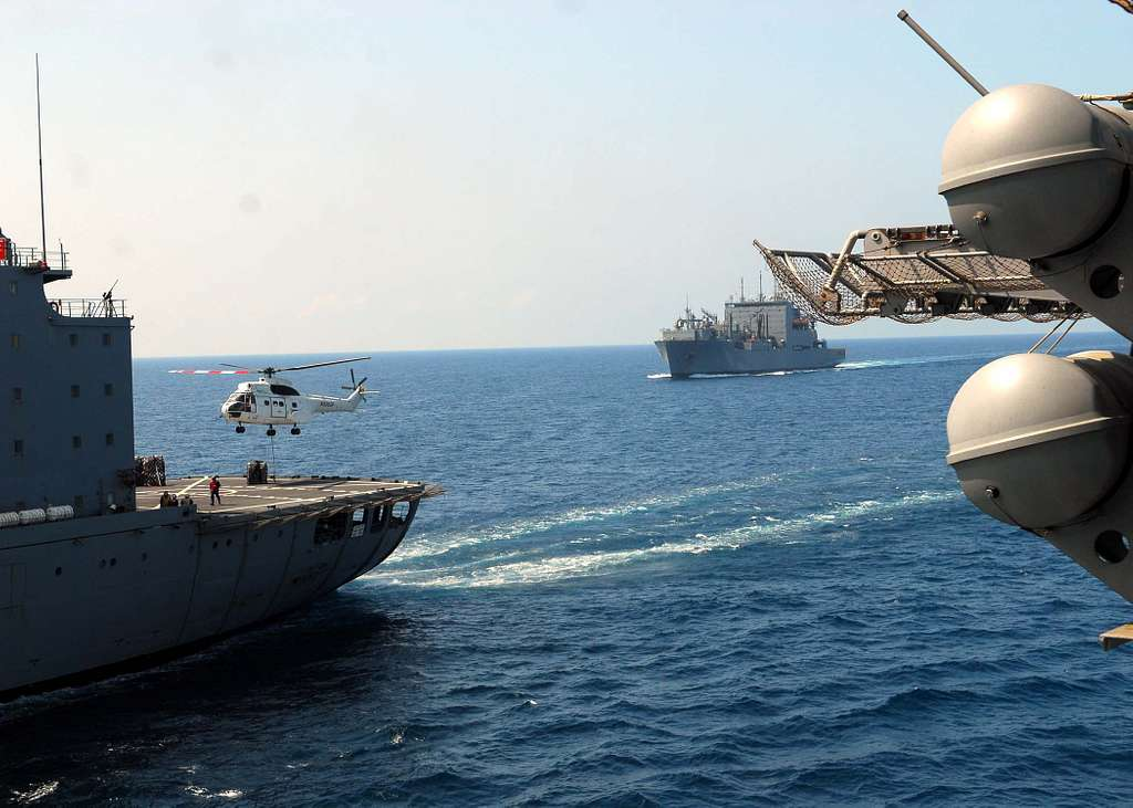 An SA-330J Puma helicopter picks up cargo from the Military Sealift Command dry cargo and ammunition ship USNS Robert E. Peary (T-AKE 5).