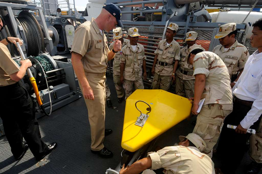 hief Mineman William Brown shows Royal Cambodian Navy officers a Klein side-scan sonar aboard the mine counter-measures ship USS Patriot (MCM 7).