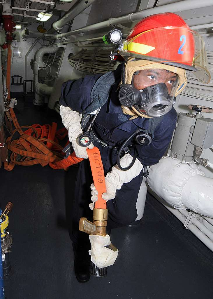 Culinary Specialist Seaman Mario D. Swift, from Folkston, Ga., handles a hose during an engineering fire drill.
