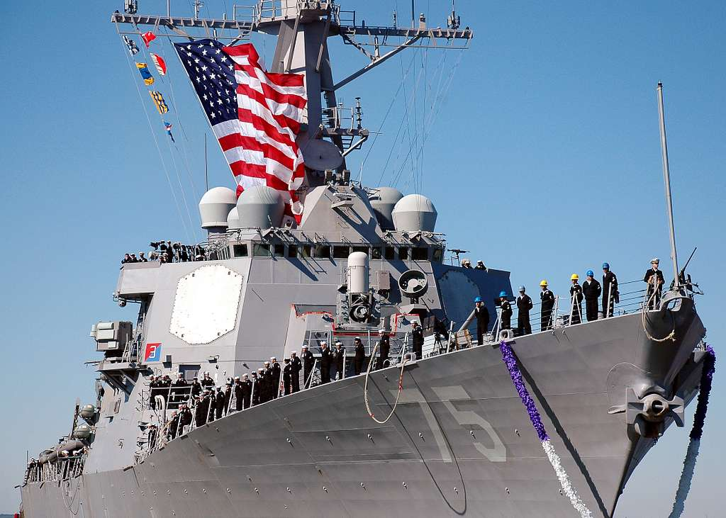 Sailors man the rail as USS Donald Cook (DDG 75) returns to Naval Station Norfolk following a seven-month deployment.