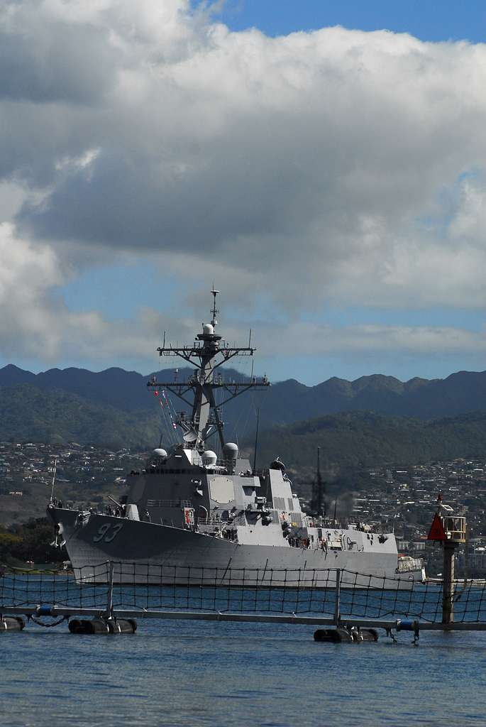 The guided-missile destroyer USS Chung-Hoon (DDG 93) makes its way out of Naval Station Pearl Harbor as the state of Hawaii is expecting a tsunami generated by an earthquake near Chile.
