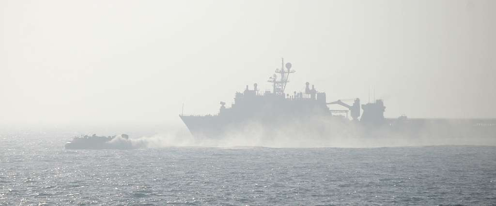 A landing craft air cushion (LCAC) launches from the well deck of the amphibious dock landing ship USS Tortuga (LSD 46)
