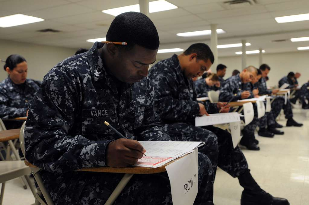 Aviation Boatswain's Mate (Fuel) 2nd Class Kimaneskie Vance completes an answer sheet during the E-6 advancement exam.