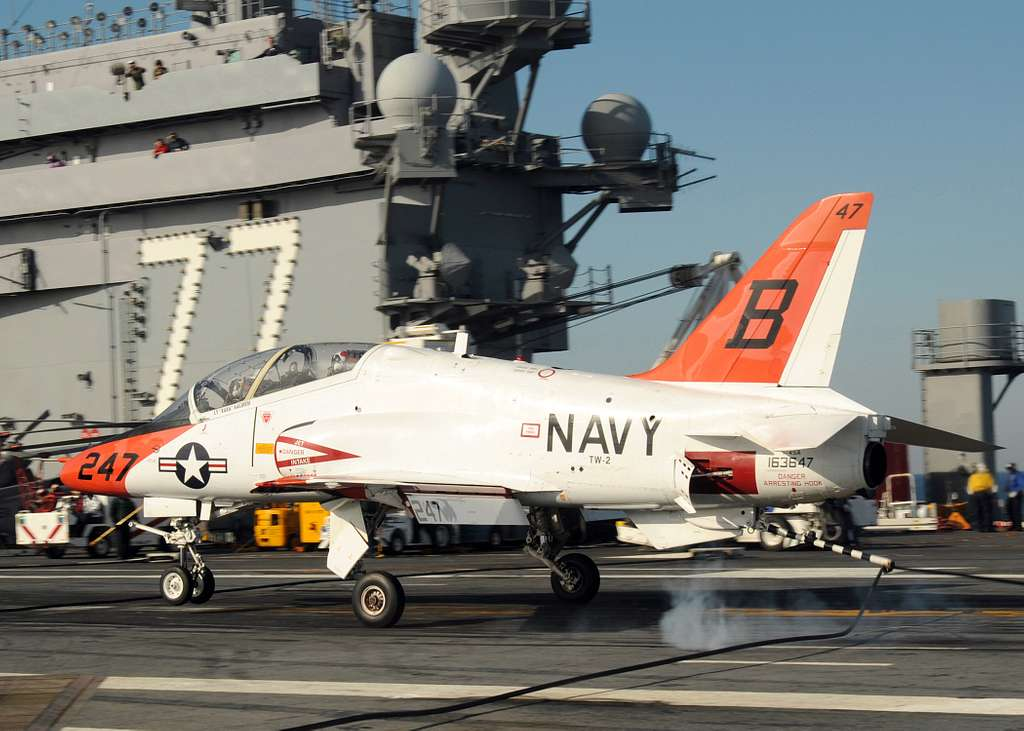 A T-45B Goshawk training aircraft assigned to Training Wing (TRAWING) 2 lands aboard the aircraft carrier USS George H.W. Bush (CVN 77)