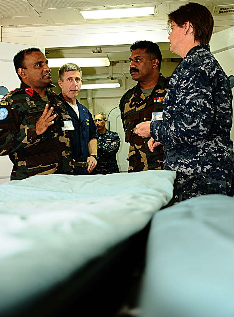 Col. K.J. Jagaweera, left, Commander of the 11th Sri Lankan Contingent, speaks with Cmdr. Melanie Merrick, senior medical officer aboard the multipurpose amphibious assault ship USS Bataan (LHD 5).