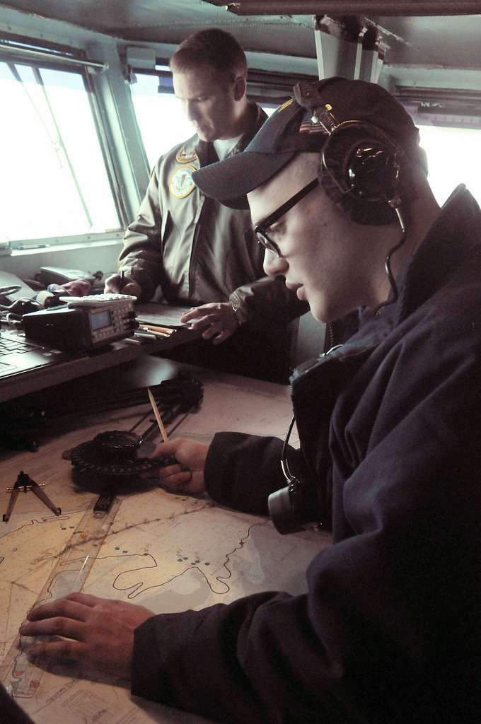 Quartermaster Seaman Erich Hoffman, from Cleveland, Ohio, plots the location of the Nimitz-class aircraft carrier USS Carl Vinson (CVN 70), during a transit of the Strait of Magellan.