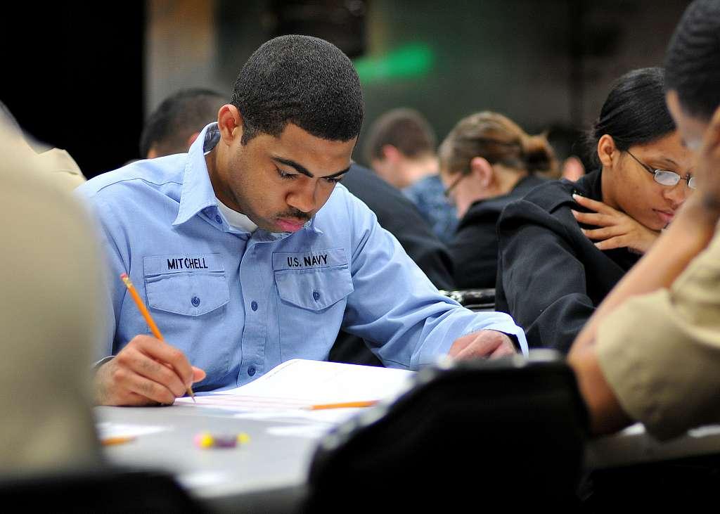 Logistics Specialist Seaman Ernest Mitchell takes the Navy-wide petty officer 3rd class advancement exam at Commander, Fleet Activities Yokosuka.