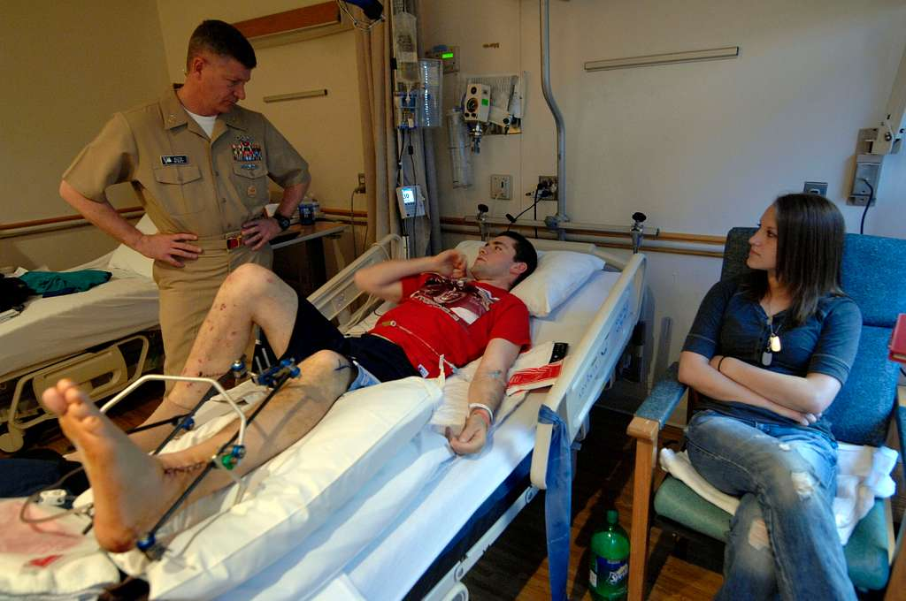 Master Chief Petty Officer of the Navy (MCPON) Rick West meets with U.S. Marine Lance Cpl. Robert Sparks III during his visit to National Naval Medical Center Bethesda, Md.