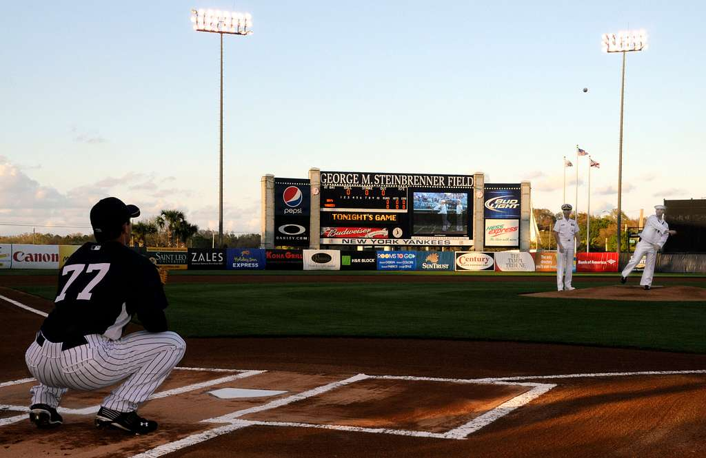 Navy Counselor 2nd Class Paul Lacey, assigned to Navy Recruiting District Miami, throws out the first pitch at a New York Yankees spring training game at Steinbrenner Field in Tampa, Fla.