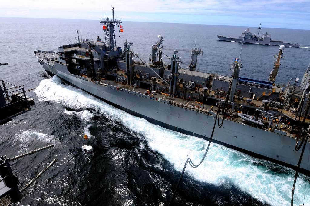 USS Carl Vinson (CVN 70) receives fuel from USNS Rainier (T-AOE 7) while the guided-missile cruiser USS Bunker Hill (CG 52)