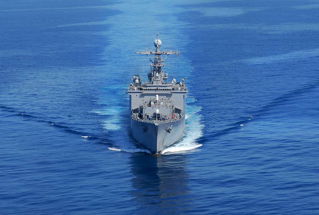 The amphibious dock landing ship USS Pearl Harbor (LSD 51) transits the coast of Southern California while conducting a composite training unit exercise.