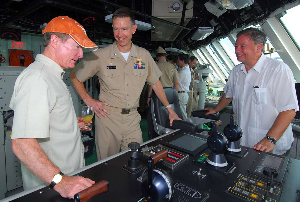 U.S. Ambassador to Colombia William Brownfield, left, examines the main control console on the bridge of the littoral combat ship USS Freedom (LCS 1).