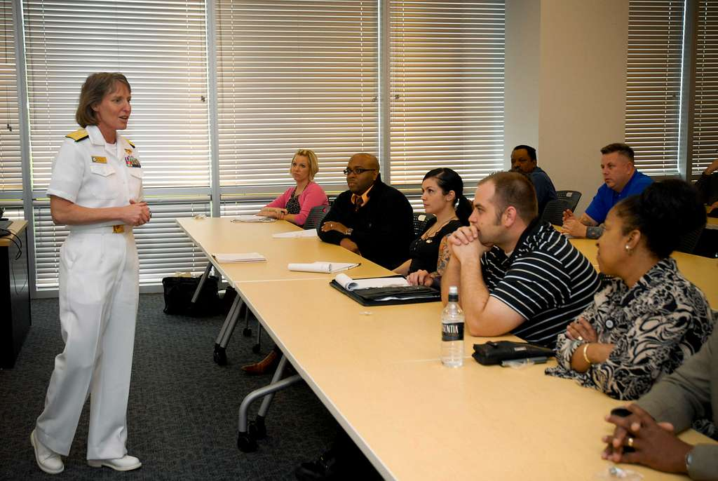 Rear Adm. Robin Graf, deputy commander of Navy Recruiting Command, discusses the U.S. Navy maritime strategy with military division employees at the University of Phoenix.