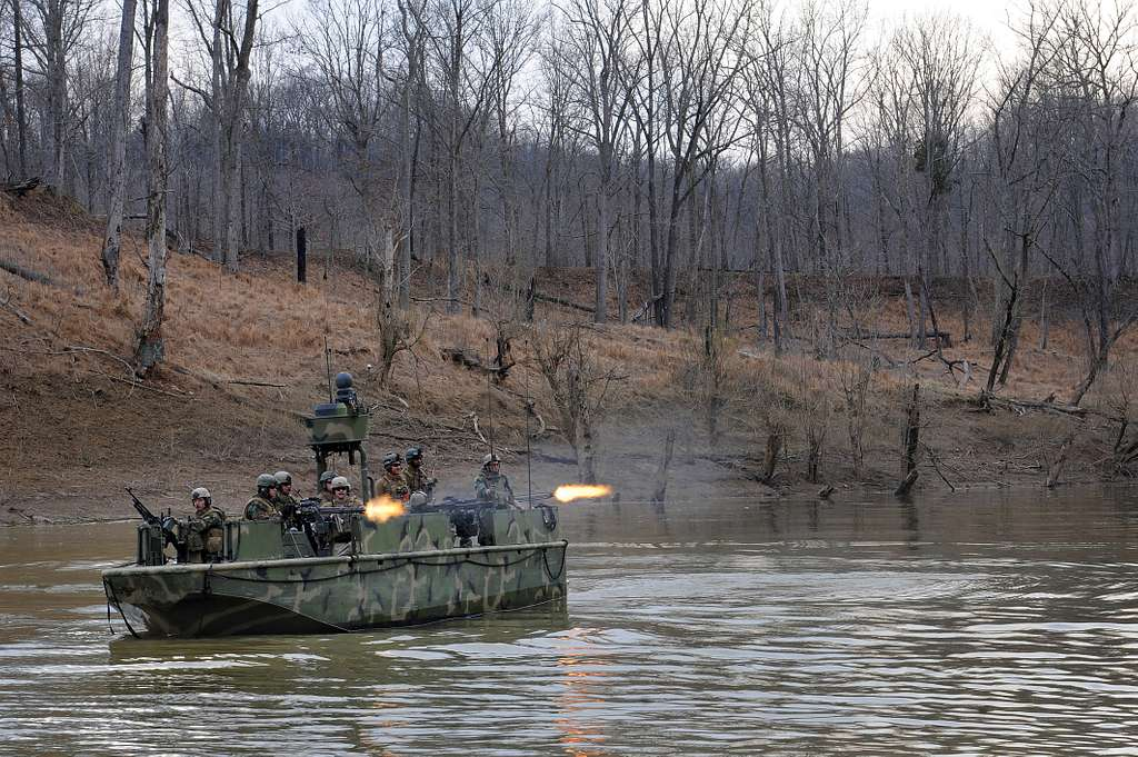 A riverine assault boat assigned to Riverine Squadron (RIVRON) 1 provides cover while Riverine Security Team takes control of the shore during a six-day field exercise at Ft. Knox, Ky.