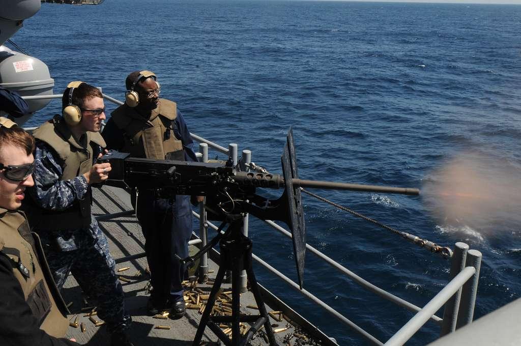 Electronics Technician 3rd Class Matthew Oliger fires a .50-caliber machine gun for a qualification aboard the amphibious assault ship USS Kearsarge (LHD 3).